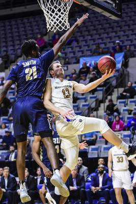 Mike Moore | The Journal Gazette  Purdue Fort Wayne forward Matt Holba drives to the basket in the first half against Oral Roberts at Memorial Coliseum on Thursday.