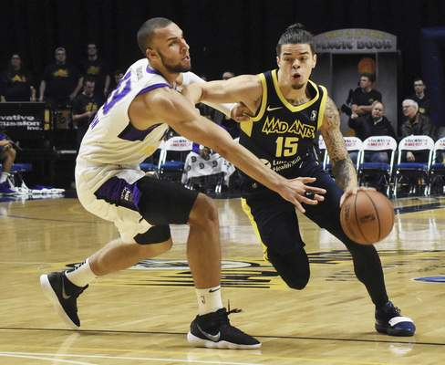 Rachel Von | The Journal Gazette The Mad Ants' Rob Gray tries to keep the ball away from the Stockton Kings' Taren Sullivan, a native of Lima, Ohio, at Monday's game.