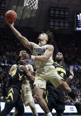 Purdue's matchup against Wisconsin tonight in Madison features two of the Big Ten's top three scorers, Carsen Edwards (pictured) and Wisconsin's Ethan Happ. (AP Photo/Michael Conroy, File)