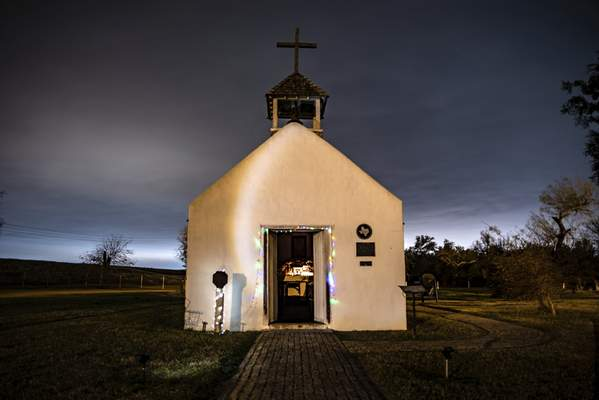 Washington Post photos Christmas lights line the doorway of the La Lomita Chapel in Mission, Texas. The chapel, a historic landmark, sits on land the U.S. government is examining as a potential path for a border wall.