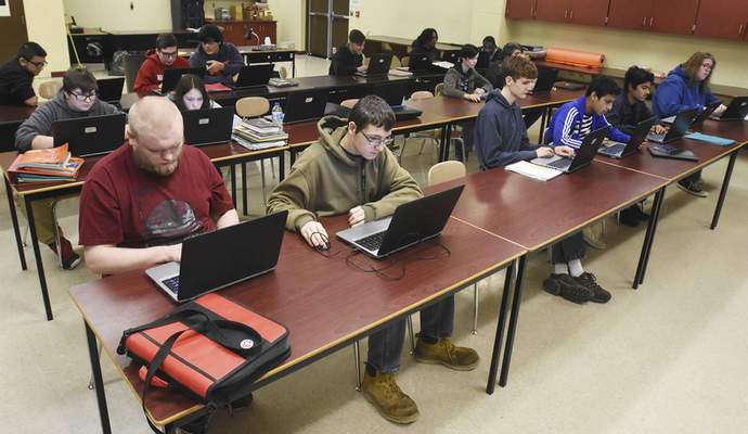 Students work on Javascript Applications during Andrew Schmitz's Computer Science class at North Side High School on Thursday January 10, 2019.
