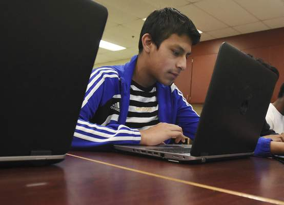 Landon Herrera, 9th grade, works on Javascript Applications during Andrew Schmitz's Computer Science class at North Side High School on Thursday January 10, 2019.