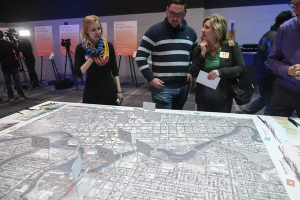 Mike Moore | The Journal Gazette Guests look at a map during the Riverfront Fort Wayne input meeting Thursday at Grand Wayne Center.