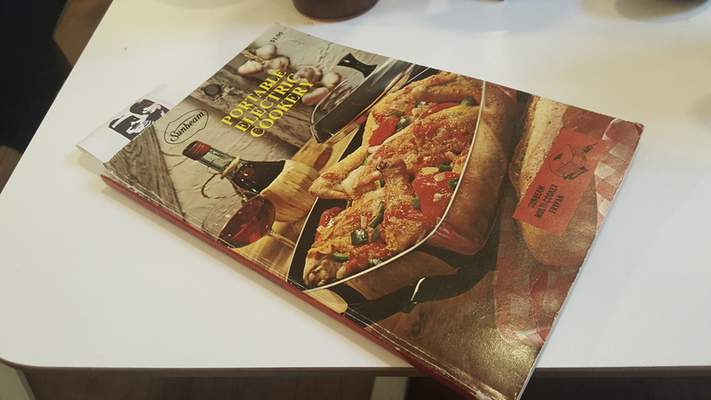 Your bill arrives in retro cookbooks at Bird and Cleaver Public House on Wells Street.