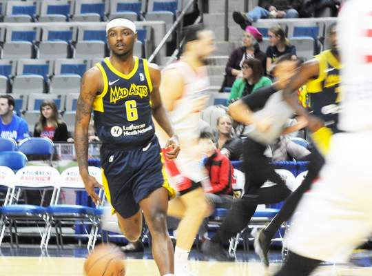 Justin A. Cohn | The Journal Gazette  Mad Ants guard Tra-Deon Hollins cuts across the Memorial Coliseum floor while Agua Caliente Clippers players hustle back on defense Monday night.