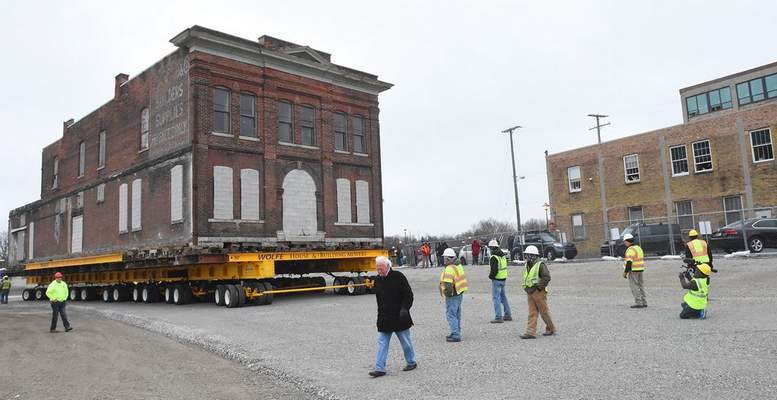 FILE: The former Cambray & Associates building is moved Monday from 312 S. Harrison St. to a temporary location at 124 W. Superior St.