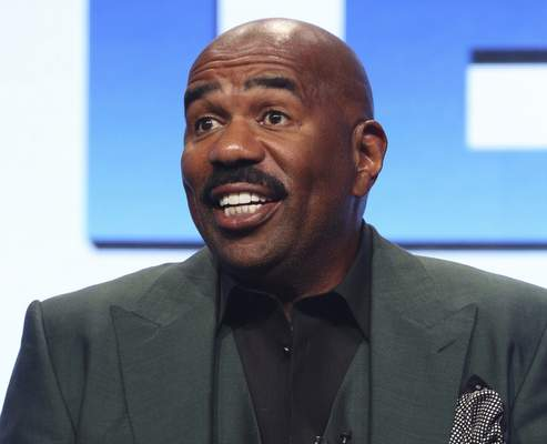 """Harvey FILE - In this Aug. 3, 2017, file photo, host/executive producer Steve Harvey participates in the """"Steve"""" panel during the NBC Television Critics Association Summer Press Tour in Beverly Hills, Calif. Steve Harvey will host the NFL Honors show on Feb. 2, 2019, when The Associated Press hands out its individual league awards. The two-hour prime-time show airing on CBS will be held at the Fox Theatre in Atlanta. (Photo by Willy Sanjuan/Invision/AP, File)"""