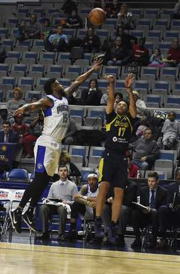 Rachel Von | The Journal Gazette  The Mad Ants' Stephan Hicks shoots the ball over the Magic's Devin Davis during the second quarter at the Coliseum on Saturday.