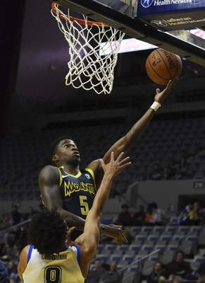 Rachel Von | The Journal Gazette  The Mad Ants' Edmond Sumner shoots the ball as the Magic's Jeremiah Hill tries to block his shot during the second quarter at the Coliseum on Saturday.