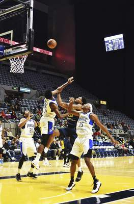 Katie Fyfe | The Journal Gazette  The Mad Ants' Travin Thibodeaux shoots the ball during the first quarter against the Magic at the Coliseum on Saturday.
