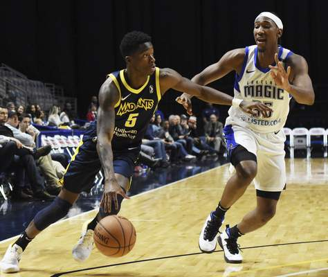 Rachel Von | The Journal Gazette  The Mad Ants' Edmond Sumner tries to get around the Magic's Melvin Frazier Jr. to get to the basket during the second quarter at the Coliseum on Saturday.