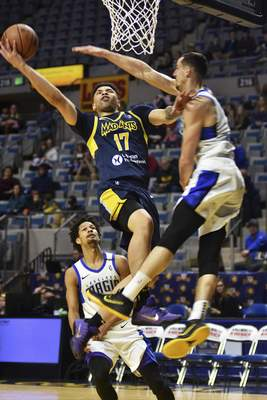 Katie Fyfe | The Journal Gazette  The Mad Ants' Stephan Hicks shoots the ball as the Magic's John Petrucelli tries to block his shot during the second quarter at the Coliseum on Saturday.
