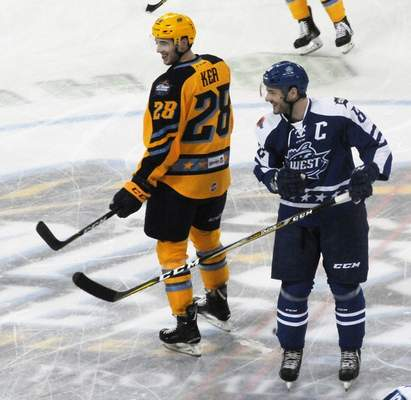 Justin A. Cohn | The Journal Gazette  Komets forward Justin Hodgman, right, who captained the Western Conference team, chats with former teammate Justin Kea, who played for one of the two host Toledo Walleye teams at the ECHL All-Star Classic at the Huntington Center on Monday at Toledo, Ohio.