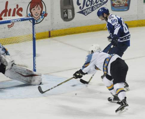 Justin A. Cohn | The Journal Gazette  The Komets' Justin Hodgman, right, sends a one-timer into the net for the Western Conference, as the Toledo Walleye's Connor Schmidt reaches to try and block it at the Huntington Center, at the All-Star Classic on Monday at Toledo, Ohio.