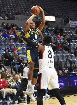 Rachel Von | The Journal Gazette: Elijah Stewart, seen here shooting over Raptors 905's Jordan Loyd during a November game at Memorial Coliseum, was traded to Wisconsin today with the returning player rights to Alex Hamilton in exchange for Jordan Barnett and Ike Nwamu.