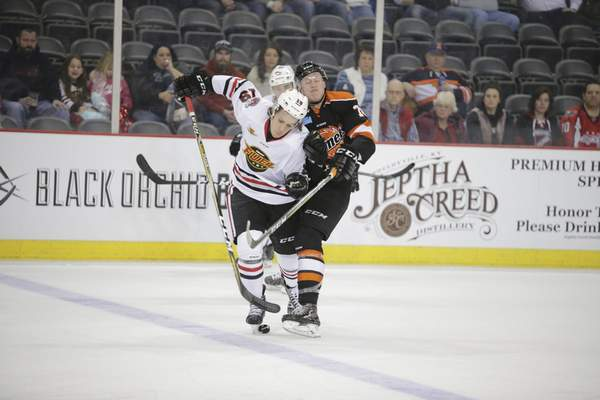 Whiteshark Photography  Komets forward Ryan Siiro, right, and Indy Fuel defenseman Robert Powers battle for the puck Friday at Indiana Farmers Coliseum in Indianapolis.