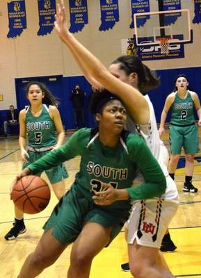 Elizabeth Wyman | The Journal Gazette  A'laya Chapman drives to the basket in South Side's sectional win over Huntington North Tuesday night.