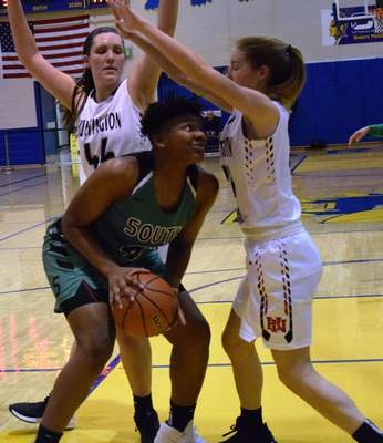 Elizabeth Wyman | The Journal Gazette  Lamiya Woodson looks shoot around two Huntington North players in South Side's sectional win over Huntington North Tuesday night.