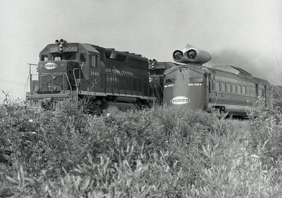 File photos A jet-powered experimental train, right, from the New York Central Railroad begins to pass a conventional train on its first test run on July 23, 1966.