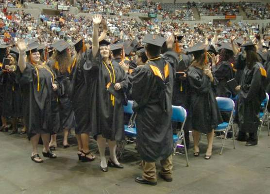 FILE: Indiana Tech graduates show their appreciation to friends and family members during commencement exercises.