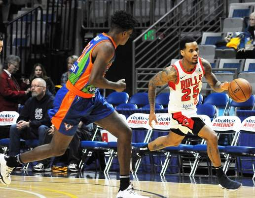 Justin A. Cohn | The Journal Gazette  Former Mad Ants star Walt Lemon Jr. hustles the ball up the Memorial Coliseum court Friday night for the Windy City Bulls as he's guarded by Alize Johnson.