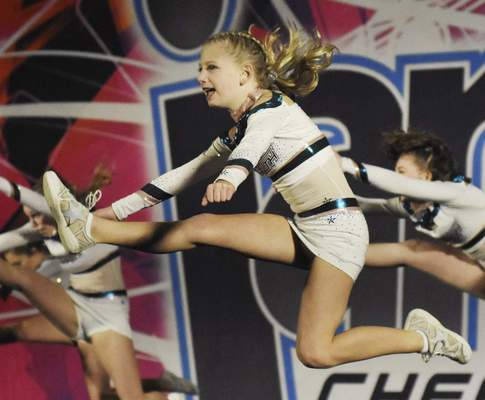 Rachel Von | The Journal Gazette Hensley Ruston, 10, performs with her team Radar, from Stealth Athletix, during the Speedy Jam cheerleading and dancing competition Saturday at Grand Wayne Center.