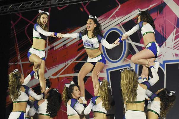 Rachel Von | The Journal Gazette  Dancers from team Cobalt from program Indiana Ultimate - Fort Wayne perform during the Speedy Jam Jamfest cheerleading and dancing competition at the Grand Wayne Center on Saturday February 16, 2019.