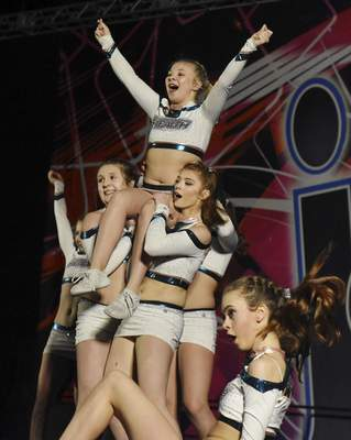 Rachel Von | The Journal Gazette  Dancers from the Sonar team from program/gym Stealth Athletix perform their show during the Speedy Jam Jamfest cheerleading and dancing competition at the Grand Wayne Center on Saturday.