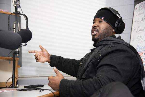 Brett Luke | The Journal Gazette  Ben Swift, a long time Fort Wayne rapper, talks about how he got started with music and how hegot to where he is now Tuesday afternoon at the Adams Radio Group station.