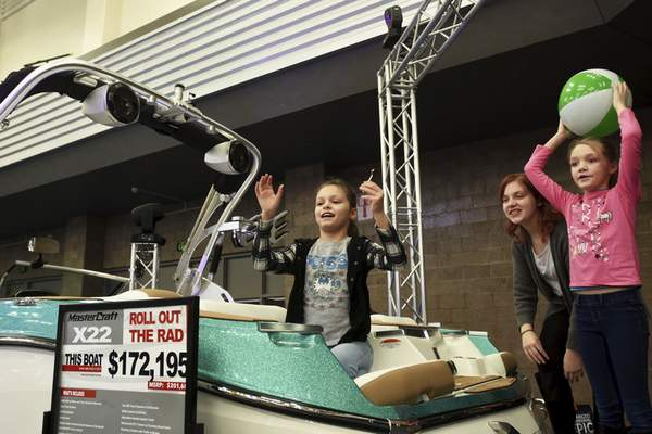 The Bowser girls play on a Master Craft X22 on display at the annual boat show that ran from Thursday to Sunday.