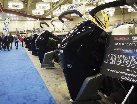 Katie Fyfe | The Journal Gazette  An aisle of pontoon boats with engines up to 300 horsepower are on display during the 34th Fort Wayne Boat Show & Sale at the Allen County War Memorial Coliseum on Sunday.
