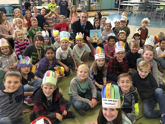 David Hoffert, superintendent of Warsaw Community Schools, sits among Washington STEM Academy first-graders.