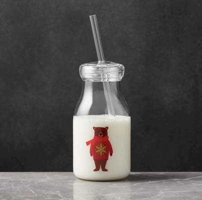 Crate and Barrel Holiday Bear acrylic milk bottle with milk.