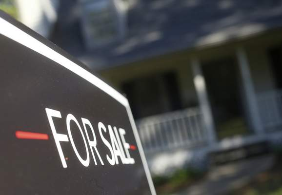 FILE- This Oct. 3, 2018, file photo shows a home offered for sale in the Atlanta suburb of Roswell, Ga. (AP Photo/John Bazemore, File)