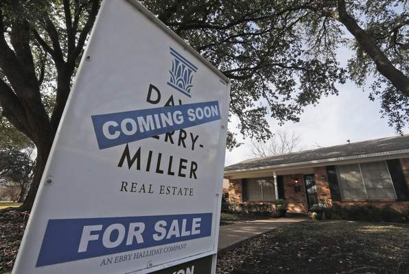In this Wednesday, Feb. 20, 2019, photo a coming soon for sale sign sits in front of a home in the Dallas suburb of Richardson, Texas. (AP Photo/LM Otero)