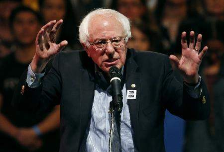 Associated Press: In this Oct. 25, 2018, file photo, Sen. Bernie Sanders, I-Vt., speaks at a rally in Las Vegas. On Friday, the Associated Press has found that stories circulating on the internet that a Chicago Tribune photo shows Sanders being arrested after a racist attack are untrue.