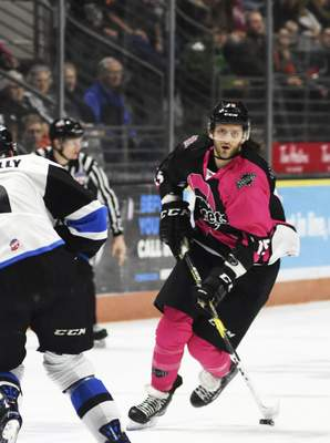 Katie Fyfe | The Journal Gazette  The Komets' J.C. Campagna hits the puck during the first period against Wichita Thunder at Memorial Coliseum on Friday.