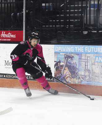 Katie Fyfe | The Journal Gazette  The Komets' Anthony Petruzzelli hits the puck during the first period against Wichita Thunder at Memorial Coliseum on Friday.