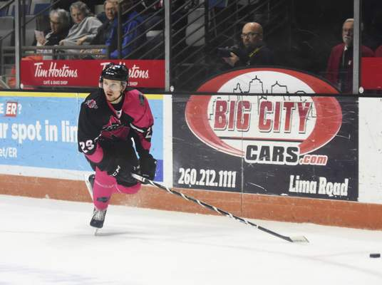 Katie Fyfe | The Journal Gazette  The Komets' Trey Phillips chases after the puck during the second period against Wichita Thunder at Memorial Coliseum on Friday.