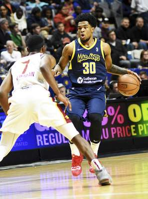 Katie Fyfe | The Journal Gazette  The Mad Ants' Jovan Mooring dribbles the ball down the court while Canton's Malik Newman guards him during the third quarter at Memorial Coliseum on Saturday.