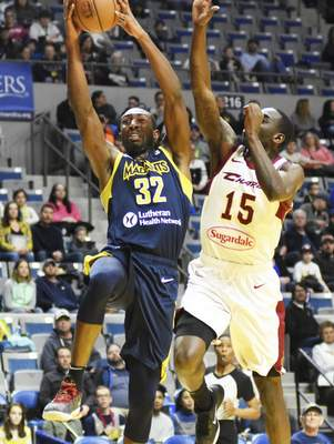 Katie Fyfe | The Journal Gazette  The Mad Ants' Davon Reed shoots the ball while Canton's Sir' Dominic Pointer tries to stop him during the first quarter at Memorial Coliseum on Saturday.