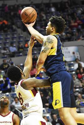 Katie Fyfe | The Journal Gazette  The Mad Ants' Stephan Hicks shoots the ball while Canton's Levi Randolph tries to stop him during the first quarter at Memorial Coliseum on Saturday.