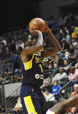 Katie Fyfe | The Journal Gazette  The Mad Ants' Omari Johnson shoots the ball during the third quarter against Canton at Memorial Coliseum on Saturday.