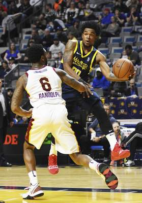 Katie Fyfe | The Journal Gazette  The Mad Ants' Jovan Mooring passes the ball while Canton's Levi Randolph tries to block him during the fourth quarter at Memorial Coliseum.