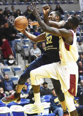 Katie Fyfe | The Journal Gazette  The Mad Ants' Davon Reed shoots the ball while Canton's Deng Adel tries to stop hiim during the first quarter at Memorial Coliseum on Saturday.