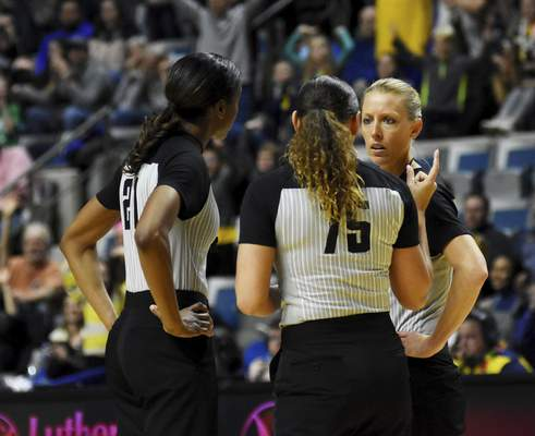 Katie Fyfe | The Journal Gazette  Referees Stephanie Barksdale, Ashley Moyer-Gleich, and Kelly Broomfield talk about the game during a time out in the fourth quarter of Mad Ants vs. Canton Charge at Memorial Coliseum on Saturday.