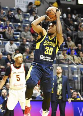 Katie Fyfe| The Journal Gazette  Jovan Mooring, right, shoots the ball for the Mad Ants at Memorial Coliseum on Saturday night as the Canton Charge's Muhammad-Ali Abdur-Rahkman, left, looks on.