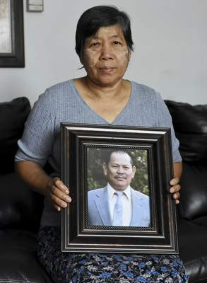 Rachel Von | The Journal Gazette Ohn Than holds a photo of her husband, Kyaw Kyaw, who collapsed and died at Nisco in 2016.