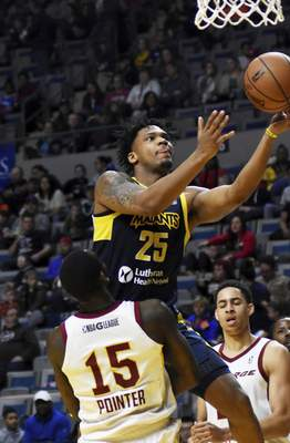 Katie Fyfe   The Journal Gazette  The Mad Ants' Travin Thibodeaux shoots the ball while Canton's Sir' Dominic Pointer tries to stop him during the third quarter at Memorial Coliseum on Saturday.