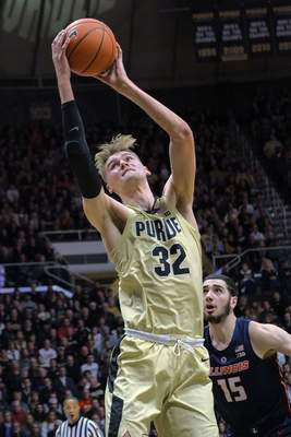 Purdue center Matt Haarms (32) shoots in front of Illinois forward Giorgi Bezhanishvili (15) during the second half of an NCAA college basketball game in West Lafayette, Ind., Wednesday, Feb. 27, 2019. Purdue won 73-56. (AP Photo/AJ Mast)